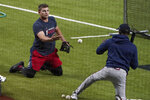 Atlanta Braves' Austin Riley, left, fields balls from third base coach Ron Washington, right, during workouts before the National League Championship Series against the Los Angeles Dodgers in Arlington, Texas, Sunday, Oct 11, 2020. The series begins Monday, Oct. 12. (AP Photo/Sue Ogrocki)