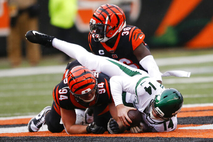 New York Jets quarterback Sam Darnold (14) is sacked by Cincinnati Bengals strong safety Shawn Williams (36) during the second half of an NFL football game, Sunday, Dec. 1, 2019, in Cincinnati. (AP Photo/Gary Landers)