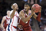 Oklahoma guard Christian James, right, makes a move on Mississippi guard Devontae Shuler (2) during a first round men's college basketball game in the NCAA Tournament Friday, March 22, 2019, in Columbia, S.C. (AP Photo/Sean Rayford)