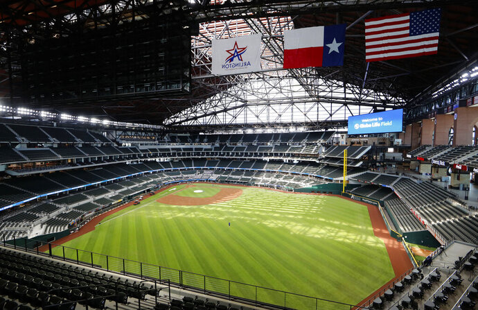 In this photo made Thursday, July 23, 2020, an upper deck view of the new Texas Rangers home baseball stadium named Globe Life Field is seen in Arlington, Texas. The Texas Rangers' new stadium isn't retro and designers wanted the first next-generation ballpark. There is the full-panel retractable roof, the split seating levels offering full views of the ballpark with plenty of natural light. (AP Photo/LM Otero)