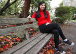 Danica Marcos, sits in a park in London, Friday, Oct. 16, 202. Danica Marcos a volunteer as U.K. researchers are preparing to begin a controversial experiment that will infect healthy volunteers with the new coronavirus to study the disease in hopes of speeding up development of a vaccine. (AP Photo/Frank Augstein)