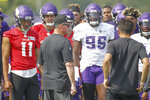 Minnesota Vikings head coach Mike Zimmer, second from left, talks to his team during NFL football training camp Friday, July 30, 2021, in Eagan, Minn. (AP Photo/Bruce Kluckhohn)