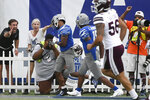 Memphis wide receiver Calvin Austin III celebrates his punt return in the end zone during the final minutes of an NCAA college football game against Mississippi State, Saturday, Sept. 18, 2021, in Memphis, Tenn. (AP Photo/John Amis)