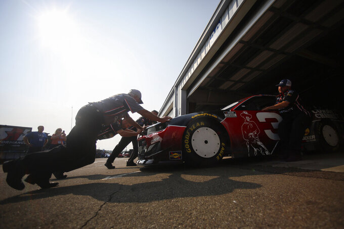 Pit crews push Austin Dillon's car after an inspection before a NASCAR Cup Series auto race in Watkins Glen, N.Y., on Sunday, Aug. 8, 2021. (AP Photo/Joshua Bessex)