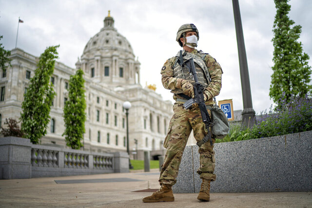 A member of the Minnesota National Guard stands guard by the State Capitol in St. Paul, Minn. Friday, May 29, 2020. Minnesota Gov. Tim Walz announced that he asked the Minnesota National Guard to be responsible for the safety of the State Capitol. (Glen Stubbe/Star Tribune via AP)