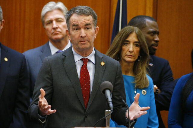 FILE - In this March 12, 2020 file photo, Virginia Gov. Ralph Northam, front, gesturers during a news conference as House speaker Eileen Filler-Corn, right, and Secretary of Public safety Brian Moran, left, look on at the Capitol in Richmond, Va. The Virginia Parole Board and its former chairwoman violated state law and its own policies and procedures in granting the release of a man convicted decades ago of killing a Richmond police officer, according to a report from the state's government watchdog agency that was initially withheld from the public. (AP Photo/Steve Helber, File)