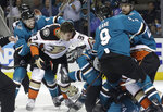 San Jose Sharks defenseman Dylan DeMelo, left, goes after Anaheim Ducks left wing Nick Ritchie (37) as players fight during the second period of Game 3 of an NHL hockey first-round playoff series in San Jose, Calif., Monday, April 16, 2018. (AP Photo/Jeff Chiu)