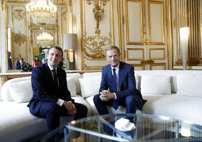 French President Emmanuel Macron, left, meets with European Council President Donald Tusk at the Elysee Palace in Paris, Monday, May 20, 2019. (Yoan Valat/Pool via AP)