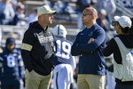 Penn State head coach James Franklin, right, talks with Purdue head coach Jeff Brohm before an NCAA college football game in State College, Pa., on Saturday, Oct. 5, 2019. Penn State defeated Purdue 35-7. (AP Photo/Barry Reeger)