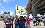 Protesters demonstrate in front of Dallas City Hall in downtown Dallas, Saturday, May 30, 2020. Protests across the country have escalated over the death of George Floyd who died after being restrained by Minneapolis police officers on Memorial Day. (AP Photo/LM Otero)