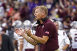 Montana head coach Bobby Hauck applauds his team's play against Washington in the second half of an NCAA college football game Saturday, Sept. 4, 2021, in Seattle. Montana won 13-7. (AP Photo/Elaine Thompson)