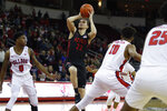 San Diego State's Malachi Flynn shoots next to Fresno State's Orlando Robinson (1) during the first half of an NCAA college basketball game in Fresno, Calif., Tuesday Jan. 14, 2020. (AP Photo/Gary Kazanjian)