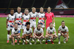 Britain team pose for a group photo prior to women's soccer match against Japan at the 2020 Summer Olympics, Saturday, July 24, 2021, in Sapporo, Japan. (AP Photo/Silvia Izquierdo)