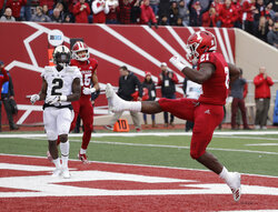 Indiana running back Stevie Scott high-steps in the endzone after scoring a touchdown in the first half of an NCAA college football game against Purdue, Saturday, Nov. 24, 2018, in Bloomington, Ind. (AP Photo/Darron Cummings)