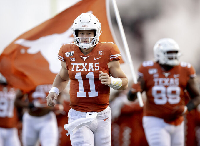 FILE - Texas quarterback Sam Ehlinger (11) runs onto the field before the team's NCAA college football game against Oklahoma State on Saturday, Sept. 21, 2019, in Austin, Texas. Ehliger gets his last chance to win a Big 12 title for 14th-ranked Texas, which lost the league championship game two years ago after beating Oklahoma earlier that season. (Nick Wagner/Austin American-Statesman via AP, File)/Austin American-Statesman via AP)