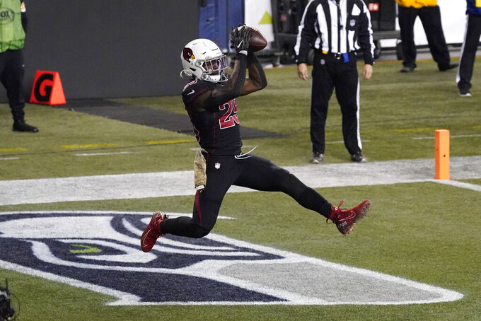 Arizona Cardinals running back Chase Edmonds (29) catches a pass for a touchdown against the Seattle Seahawks during the second half of an NFL football game, Thursday, Nov. 19, 2020, in Seattle. (AP Photo/Elaine Thompson)