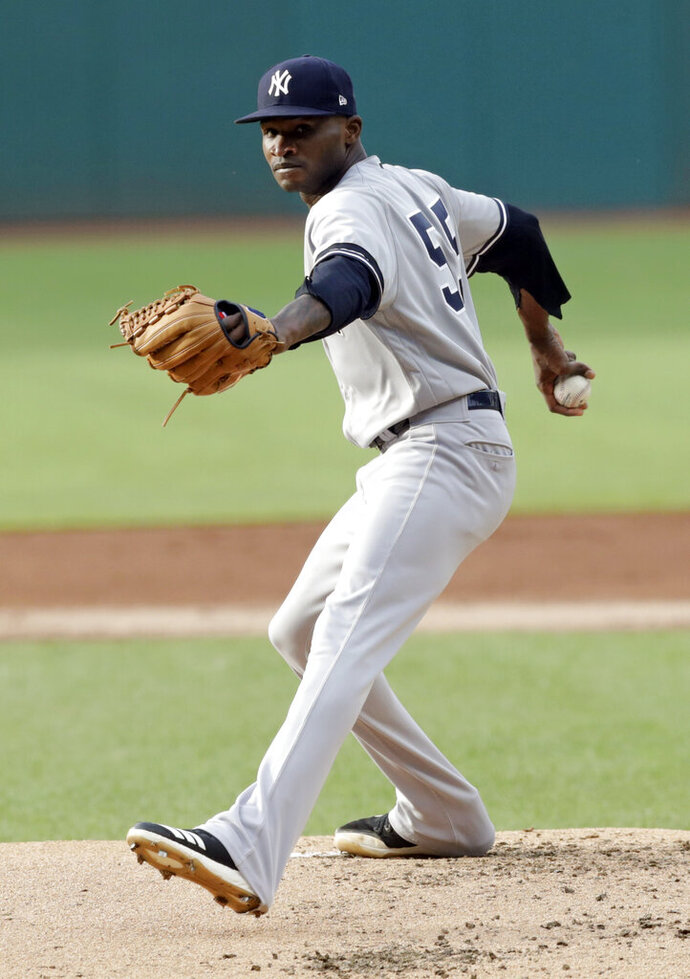 New York Yankees starting pitcher Domingo German delivers in the first inning of the team's baseball game against the Cleveland Indians, Friday, June 7, 2019, in Cleveland. (AP Photo/Tony Dejak)