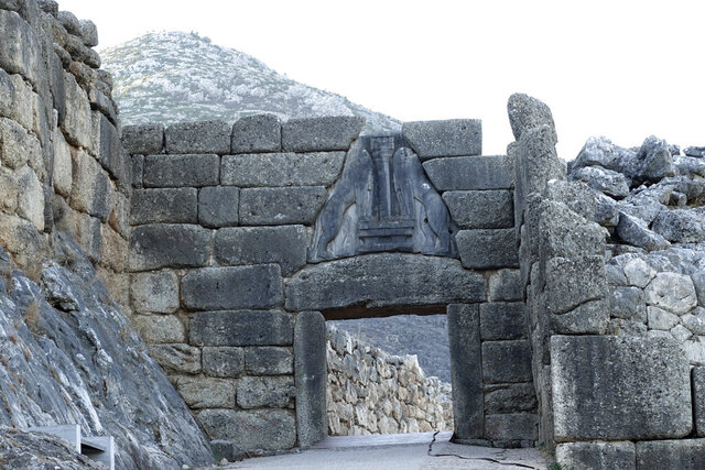 In this photo provided by the Greek Culture Ministry is seen the archaeological site of Mycenae with the 3,250-year-old Lion Gate, one day after the fire, on Monday, Aug. 31, 2020. Monuments at the archaeological site of Mycenae have not been damaged by a wildfire that swept through the area, despite blackening from smoke on the iconic entrance to the ancient citadel, Greece's culture minister said Monday, Aug. 31.(Greek Culture Ministry via AP)