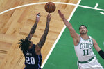 Boston Celtics center Enes Kanter (11) tries to block a shot by Orlando Magic guard Markelle Fultz (20) during the first quarter of an NBA basketball game in Boston, Wednesday, Feb. 5, 2020. (AP Photo/Charles Krupa)