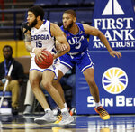 Georgia State guard D'Marcus Simonds (23) is defended by Texas-Arlington guard Edric Dennis (5) during the first half of the NCAA college basketball championship game of the Sun Belt Conference men's tournament in in New Orleans, Sunday, March 17, 2019. (AP Photo/Tyler Kaufman)