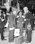 FILE - In this Oct. 7, 1949, file photo, relatives meet one of the Japanese repatriates from Manchuria and have cups of hot tea supplied by the Japanese Red Cross at the Tokyo station in Tokyo. The bombs stopped falling 75 years ago, but it is entirely possible - crucial even, some argue - to view the region's world-beating economies, its massive cultural and political reach and its bitter trade, territory and history disputes all through a single prism: Japan's aggression in the Pacific during World War II. (AP Photo, File)