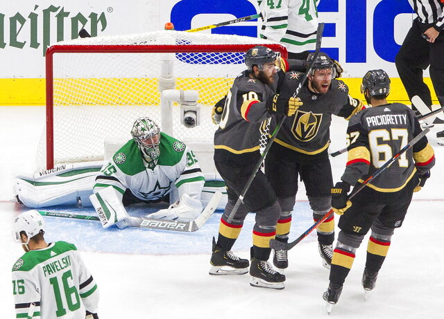 Dallas Stars goalie Anton Khudobin (35) watches as Vegas Golden Knights' Nicolas Roy (10), Paul Stastny (26) and Max Pacioretty (67) celebrate a goal during the second period of Game 2 of the NHL hockey Western Conference final, Tuesday, Sept. 8, 2020, in Edmonton, Alberta. (Jason Franson/The Canadian Press via AP)