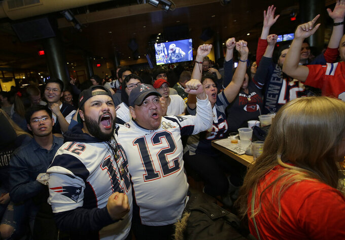 New England Patriots fans cheer while watching the second half of the NFL Super Bowl 53 football game in Atlanta between the Patriots and the Los Angeles Rams at a bar in Boston, Sunday, Feb. 3, 2019. (AP Photo/Steven Senne)