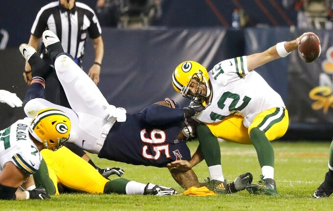 Chicago Bears' Roy Robertson-Harris sacks Green Bay Packers' Aaron Rodgers during the first half of an NFL football game Thursday, Sept. 5, 2019, in Chicago. (AP Photo/Charles Rex Arbogast)