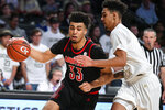 Louisville forward Jordan Nwora drives to the basket as Georgia Tech guard Michael Devoe defends during the second half of an NCAA college basketball game Saturday, Jan. 19, 2019, in Atlanta. Louisville won 79-51. (AP Photo/John Amis)