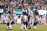Dallas Cowboys quarterback Dak Prescott, center, reacts after not completing a two-point conversion during the second half of an NFL football game, Sunday, Oct. 13, 2019, in East Rutherford, N.J. The Jets defeated the Cowboys 24-22. (AP Photo/Adam Hunger)