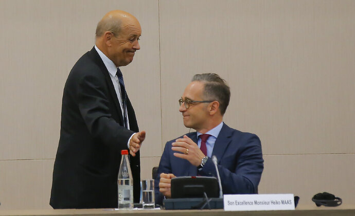 French Foreign Minister Jean-Yves Le Drian left, and German Foreign Minister Heiko Maas attend the opening session of the French ambassadors to European countries in Paris, Monday, Aug. 31, 2020. (AP Photo/Michel Euler)