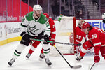 Dallas Stars center Jason Dickinson (18) passes the puck during the first period of an NHL hockey game against the Detroit Red Wings, Saturday, March 20, 2021, in Detroit. (AP Photo/Carlos Osorio)