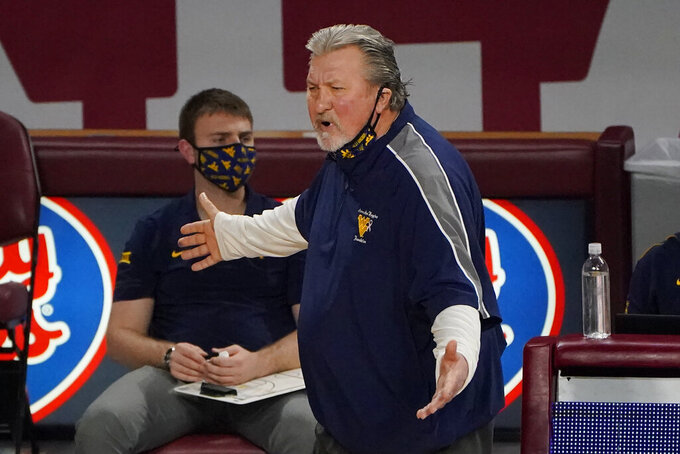 West Virginia head coach Bob Huggins gestures in the first half of an NCAA college basketball game against Oklahoma, Saturday, Jan. 2, 2021, in Norman, Okla. (AP Photo/Sue Ogrocki)