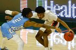 North Carolina guard Caleb Love (2) defends Miami guard Harlond Beverly (5) during the second half of an NCAA college basketball game, Tuesday, Jan. 5, 2021, in Coral Gables, Fla. (AP Photo/Marta Lavandier)