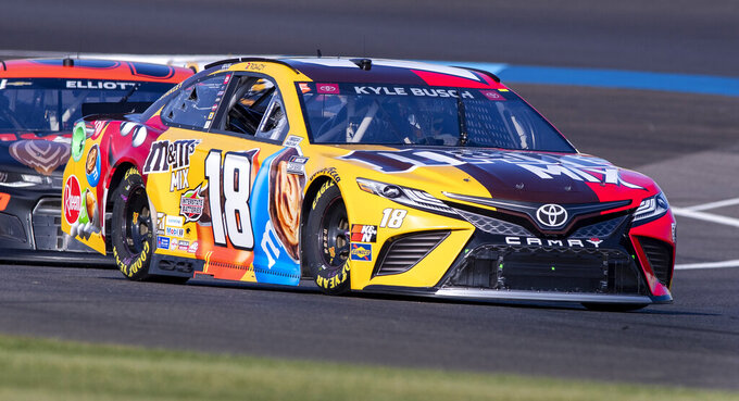 Kyle Busch (18) during qualifying for a NASCAR Cup Series auto race at Indianapolis Motor Speedway, Sunday, Aug. 15, 2021, in Indianapolis. (AP Photo/Doug McSchooler)