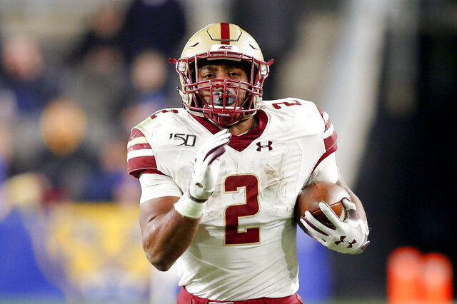 FILE - In this Nov. 30, 2019, file photo, Boston College running back AJ Dillon (2) runs over 50 yards for a touchdown against Pittsburgh during the second half of an NCAA college football game in Pittsburgh. Dillon was selected by the Green Bay Packers in the second round of the NFL football draft Friday, April 24, 2020. (AP Photo/Keith Srakocic, File)