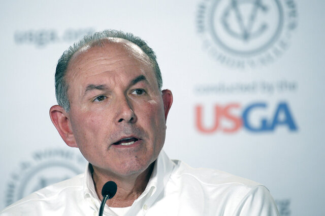 "FILE - In this July 10, 2016, file photo, John Bodenhamer, the USGA senior managing director of championship, answers questions during a press conference in San Martin, Calif. The COVID-19 pandemic, which already has postponed the U.S. Open from June to September, has forced the USGA to do away with qualifying for the first time since 1924. ""As you can imagine, this was an incredibly difficult decision, as qualifying is a cornerstone of USGA championships,"" said Bodenhamer. (AP Photo/Eric Risberg)"