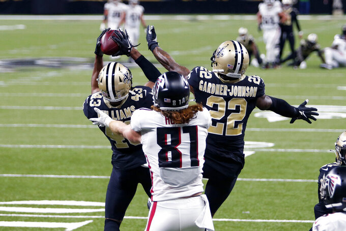 New Orleans Saints free safety Marcus Williams (43) intercepts a deep pass bu Atlanta Falcons quarterback Matt Ryan in the first half of an NFL football game in New Orleans, Sunday, Nov. 22, 2020. (AP Photo/Brett Duke)