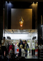 Palestinians shop for traditional Ramadan lanterns for the month of Ramadan, at the main market in Gaza City, Wednesday, May 16, 2018. Muslims throughout the world are preparing to celebrate Ramadan, the holiest month in the Islamic calendar, refraining from eating, drinking, smoking and sex from sunrise to sunset. (AP Photo/Hatem Moussa)
