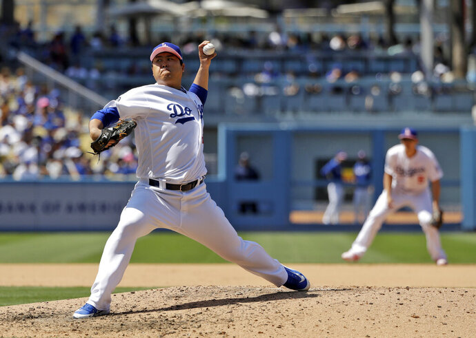 Los Angeles Dodgers starting pitcher Hyun-Jin Ryu throws to the Washington Nationals during the sixth inning of a baseball game Sunday, May 12, 2019, in Los Angeles. (AP Photo/Marcio Jose Sanchez)