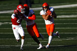 Illinois running back Chase Brown (2) rushes past Rutgers defensive back Tre Avery (21) during the second half of an NCAA college football game, Saturday, Nov. 14, 2020, in Piscataway, N.J. Illinois won 23 - 20. (AP Photo/Adam Hunger)