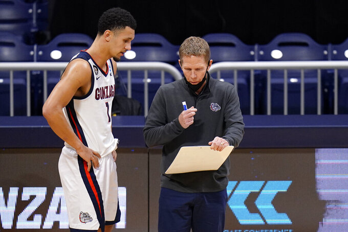 Gonzaga head coach Mark Few, right, talks with his player Jalen Suggs while their team plays Oklahoma in the first half of a college basketball game in the second round of the NCAA tournament at Hinkle Fieldhouse in Indianapolis, Monday, March 22, 2021. (AP Photo/AJ Mast)