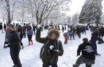 Several hundred people take part in a public snowball fight, Saturday, Feb. 9, 2019, at Wright Park in Tacoma, Wash. Word of the friendly battle spread on social media Friday night and Saturday, as a winter storm that blanketed Washington state with snow moved south into Oregon and meteorologists warned that yet more winter weather was on the way. (AP Photo/Ted S. Warren)