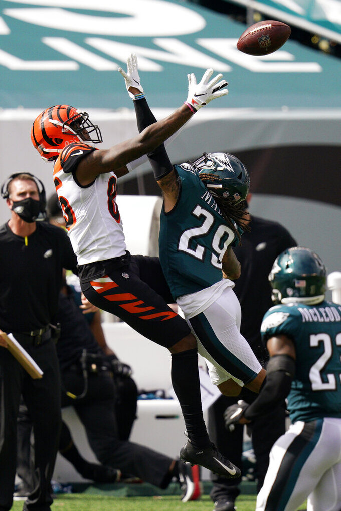 Cincinnati Bengals' Tee Higgins (85) cannot catch a pass against Philadelphia Eagles' Avonte Maddox (29) during the first half of an NFL football game, Sunday, Sept. 27, 2020, in Philadelphia. (AP Photo/Chris Szagola)