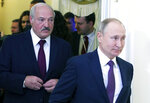 FILE - In this file photo taken on Friday, Dec. 20, 2019, Russian President Vladimir Putin, right, and Belarusian President Alexander Lukashenko walk before a meeting of the Supreme Eurasian Economic Council in St. Petersburg, Russia. Russia has halted oil supplies to Belarus Friday Jan. 3, 2020, after the two countries failed to renegotiate a contract amid talks of further improving their economic ties. (Mikhail Klimentyev, Sputnik, Kremlin Pool Photo via AP, File)