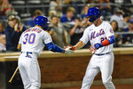New York Mets' Michael Conforto, left, celebrates with New York Mets' Pete Alonso, wearing Pittsburgh Pirates Hall of Fame player Roberto Clemente's No. 21 on Roberto Clemente Day, after Alonso hit a home run during the second inning of a baseball game against the St. Louis Cardinals Wednesday, Sept. 15, 2021, in New York. (AP Photo/Frank Franklin II)