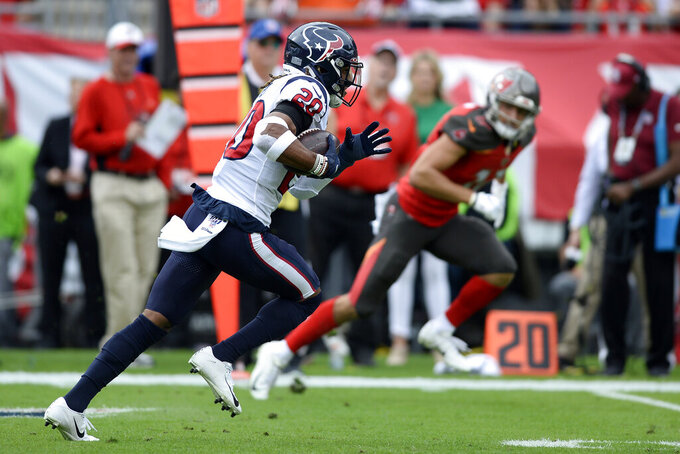 Houston Texans strong safety Justin Reid (20) runs with the football after intercepting a pass by Tampa Bay Buccaneers quarterback Jameis Winston during the first half of an NFL football game Saturday, Dec. 21, 2019, in Tampa, Fla. (AP Photo/Jason Behnken)