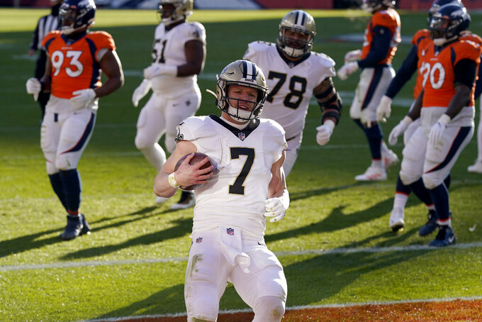 New Orleans Saints quarterback Taysom Hill (7) runs in for a touchdown against the Denver Broncos during the first half of an NFL football game, Sunday, Nov. 29, 2020, in Denver. (AP Photo/David Zalubowski)