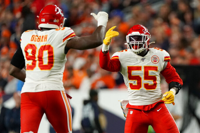 Kansas City Chiefs defensive end Frank Clark (55) celebrates his sack against the Denver Broncos with defensive end Emmanuel Ogbah (90) during the first half of an NFL football game, Thursday, Oct. 17, 2019, in Denver. (AP Photo/Jack Dempsey)