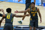 Baylor guard Jared Butler (12) celebrates with teammate guard Adam Flagler (10) during the second half of the championship game against Gonzaga in the men's Final Four NCAA college basketball tournament, Monday, April 5, 2021, at Lucas Oil Stadium in Indianapolis. (AP Photo/Darron Cummings)
